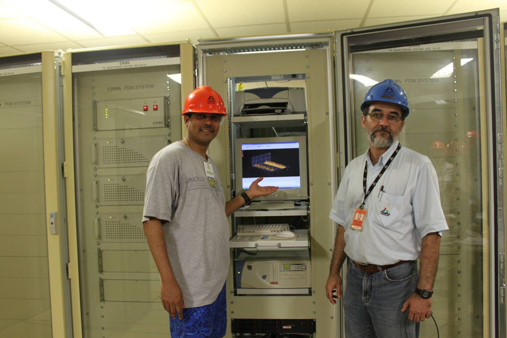 Dr. Venayagamoorthy with an Engineer at the Itaipu Power Plant looking at a neural network application.